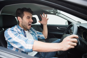 Young man experiencing road rage